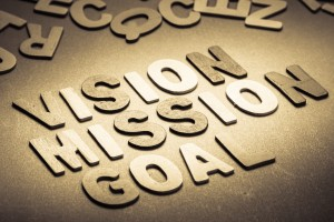 Vision, Mission and Goal words in small wood letters