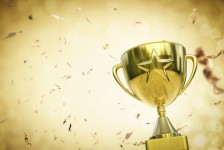 gold star trophy on gold background